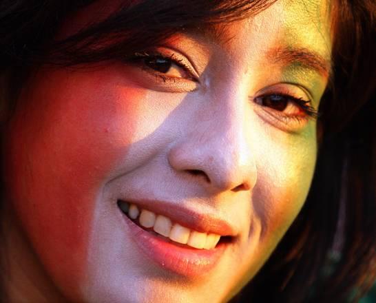 Mondiali, il tramonto scalda il viso d'una tifosa messicana -