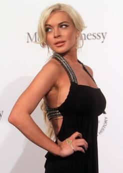 Moda Milano: John Legend e Lindsay Lohan a Gala Amfar -
